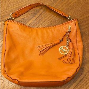 Orange/ tangerine tassel hobo bag